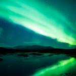 een sfeerfoto van het Noorderlicht. Een prachtig natuurverschijnsel door de Zonnewind. Het gevolg van het afnemen van het beschermende aard-magnetisch veld rondom de aarde